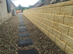 Drainage and retaining wall in sideway